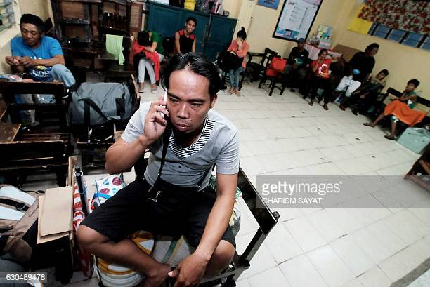 Stranded passengers from Tabaco port are housed temporarily at the Tacabo National High School in Tabaco City Albay province on December 24 after...
