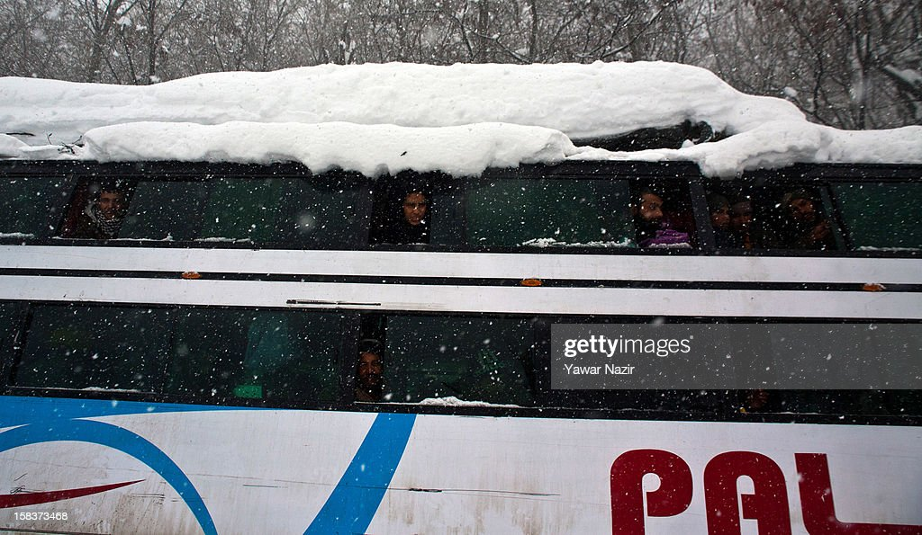 Stranded passengers look out from their stranded vehicle amid heavy snowfall on highway on December 14, 2012, in Banihal, 110 km (68 miles) south of Srinagar, the summer capital of Indian Administered Kashmir, India. Most parts of the Kashmir Valley, including Srinagar, received fresh snowfall, leading to closure of the 300 km (188 miles) Jammu-Srinagar Highway, the only road link between Kashmir and rest of India. Project Beacon authorities of the Border Roads Organisation, that maintains the highway, had already started efforts to clear the highway for traffic. The number of vehicles stranded on the highway was being ascertained.
