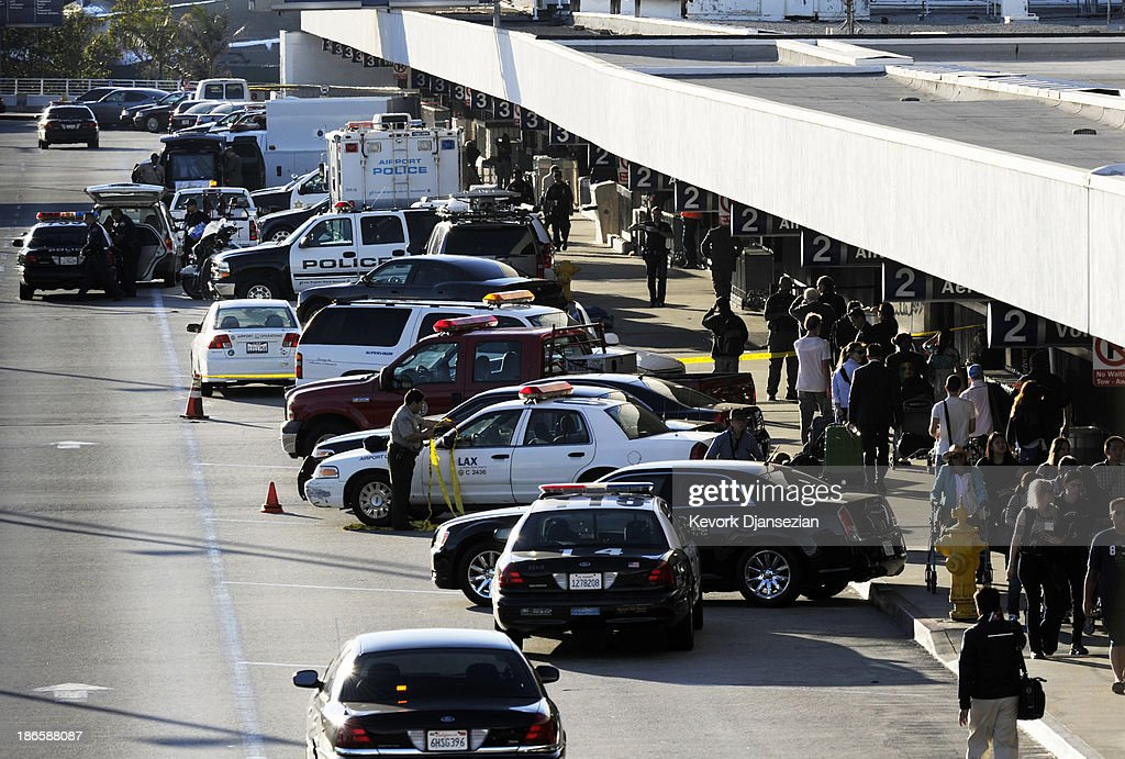 Stranded passengers return to Terminal 2 as normal operations slowly returns at Los Angeles International Airport (LAX) after a shooting incident November 1, 2013 in Los Angeles, California. A man identified as Paul Ciancia reportedly pulled out an assault rifle in Terminal 3 of the airport and shot his way through security, killing one Transportation Security Administration (TSA) worker and wounding several others before being shot himself.