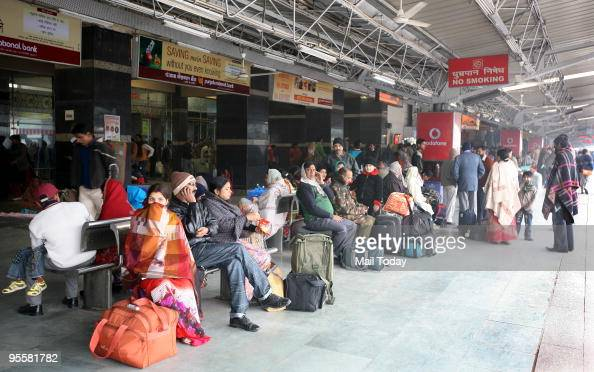 Stranded passengers wait at the New Delhi Railway station on January 2 2010 railway station on Saturday as train services were disrupted due to heavy...