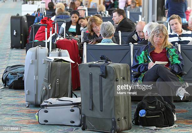 Stranded passengers wait for a flight with their luggage at Ft Lauderdale Hollywood International Airport Monday December 272010