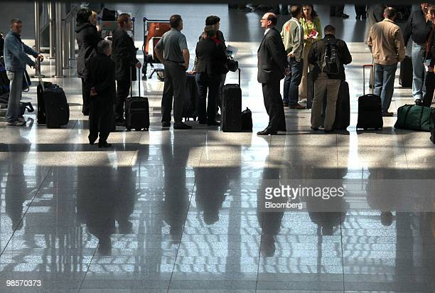 Stranded passengers wait for travel information at Frankfurt International Airport in Frankfurt Germany on Tuesday April 20 2010 European airspace...