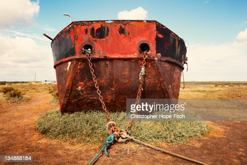 Stranded rusted boat : Stock Photo