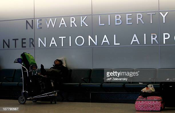 A stranded traveler rests in the baggage claim area of Newark Liberty International Airport Terminal B following a major blizzard on December 27 2010...