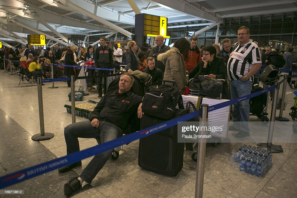 Stranded travelers wait in line at Heathrow airport Terminal 5 to reschedule flights after snow hit the region January 19, 2013 in London, England. Heavy snow around the UK caused hundreds of flight cancelations at Heathrow, with more travel disruptions expected during a snowy weekend. Approximately 3,000 schools were closed in England, Wales and Scotland.