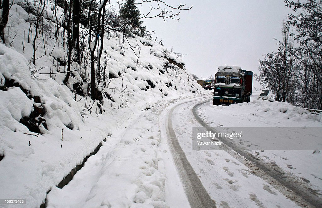 Stranded trucks carrying essential supply are seen amid heavy snowfall on December 14, 2012, in Banihal, 110 km (68 miles) south of Srinagar, the summer capital of Indian Administered Kashmir, India. Most parts of the Kashmir Valley, including Srinagar, received fresh snowfall, leading to closure of the 300 km (188 miles) Jammu-Srinagar Highway, the only road link between Kashmir and rest of India. Project Beacon authorities of the Border Roads Organisation, that maintains the highway, had already started efforts to clear the highway for traffic. The number of vehicles stranded on the highway was being ascertained.