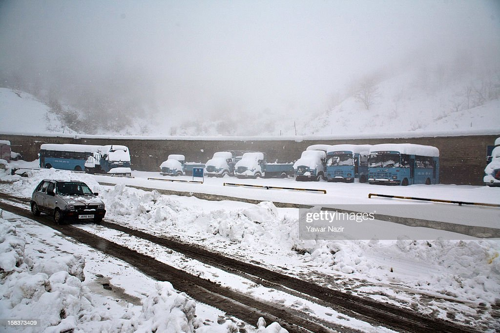A stranded vehicle negotiates amid heavy snowfall near Jawahar Tunnel on highway on December 14, 2012 in Banihal, 110 km (68 miles) south of Srinagar, the summer capital of Indian Administered Kashmir, India. Most parts of the Kashmir Valley, including Srinagar, received fresh snowfall, leading to closure of the 300 km (188 miles) Jammu-Srinagar Highway, the only road link between Kashmir and rest of India. Project Beacon authorities of the Border Roads Organisation, that maintains the highway, had already started efforts to clear the highway for traffic. The number of vehicles stranded on the highway was being ascertained.