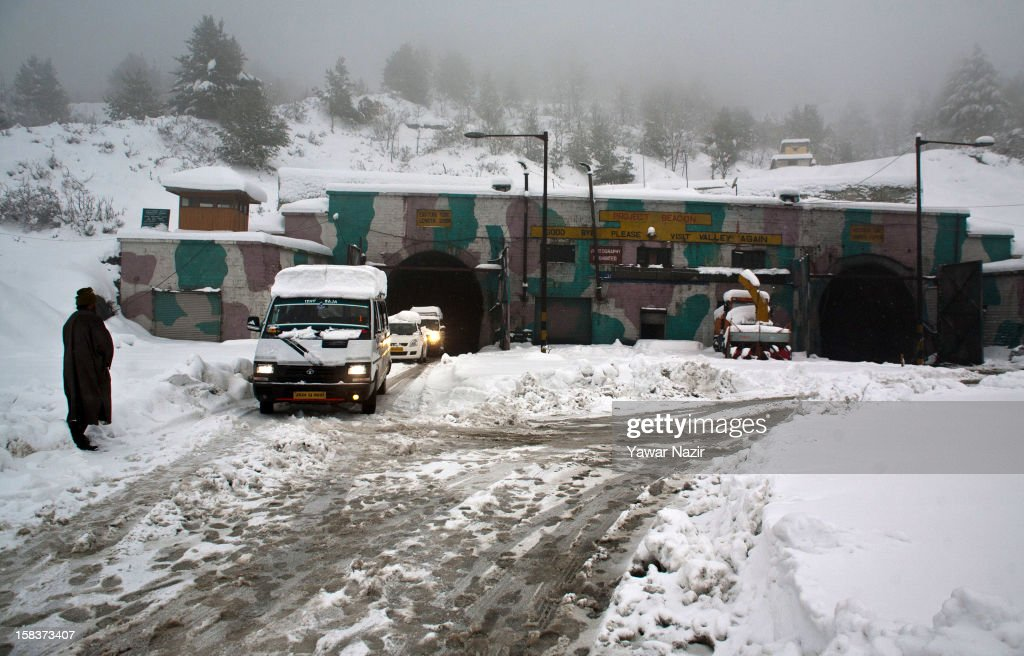 stranded vehicles coming out of Jawahar Tunnel negotiates on highway amid heavy snowfall on December 14, 2012 in Banihal, 110 km (68 miles) south of Srinagar, the summer capital of Indian Administered Kashmir, India. Most parts of the Kashmir Valley, including Srinagar, received fresh snowfall, leading to closure of the 300 km (188 miles) Jammu-Srinagar Highway, the only road link between Kashmir and rest of India. Project Beacon authorities of the Border Roads Organisation, that maintains the highway, had already started efforts to clear the highway for traffic. The number of vehicles stranded on the highway was being ascertained.