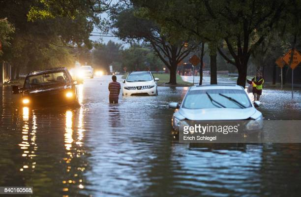Stranded vehicles sit where they got stuck in high water from Hurricane Harvey on Dairy Ashford Drive August 28 2017 in Houston Texas Harvey made...