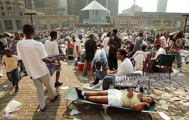 Stranded victims of Hurricane Katrina wait outside the Superdome to be evacuated September 2 2005 in New Orleans Louisiana Thousands of troops poured...