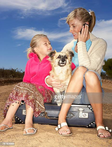 Stranded Woman with Daughter and Dog