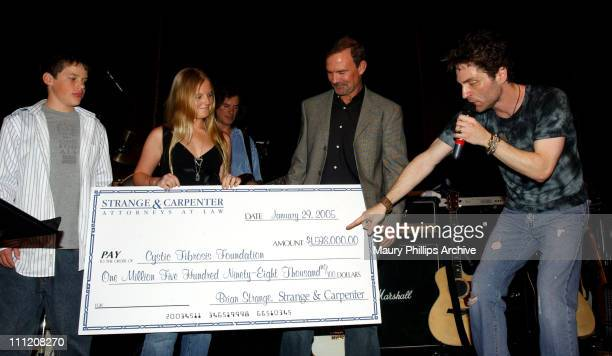 Strange Carpenter presents a check for One Million Five Hundred NinetyEight Thousand Dollars to the Cystic Fibrosis Foundation LtoR Johnny Strange...