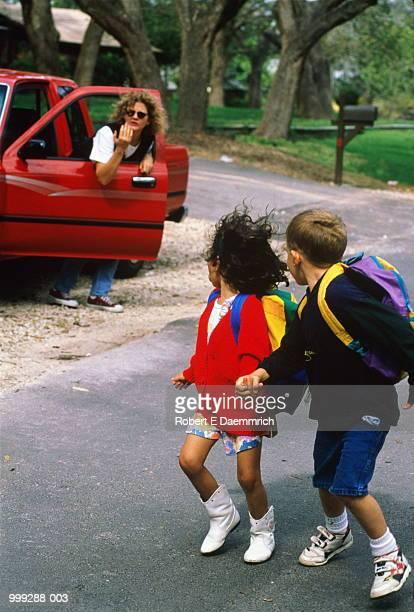 Stranger beckoning children (5-7) towards car