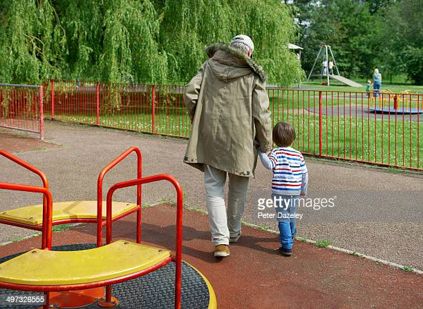 Stranger leading child out of playground