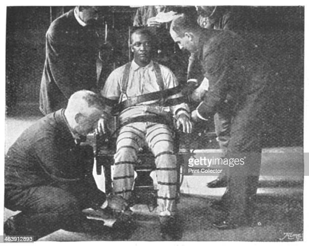 'Strapping the Victim into the Death Chair' United States 1898 The operation takes only a couple of seconds to perform each keeper being thoroughly...