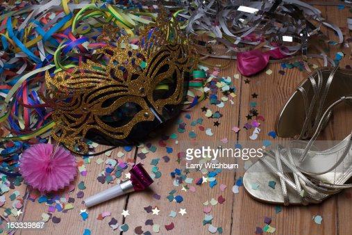 Strappy heels and party decorations littering a hardwood floor