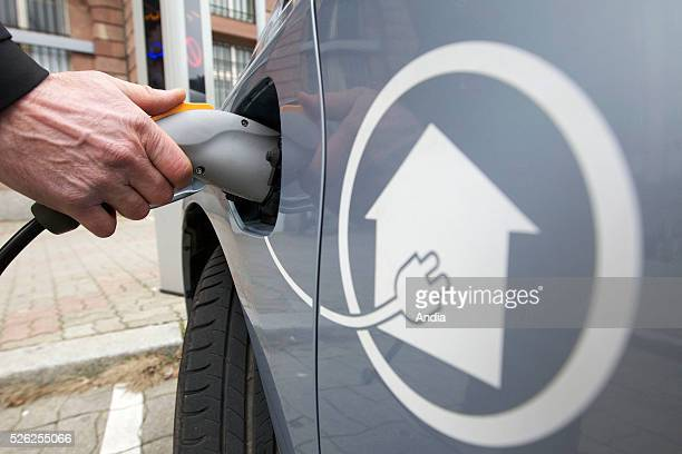 Strasbourg Charging of a Toyota Prius hybridelectric car batteries from a charging station in 'place de la Bourse' square The urban community of...