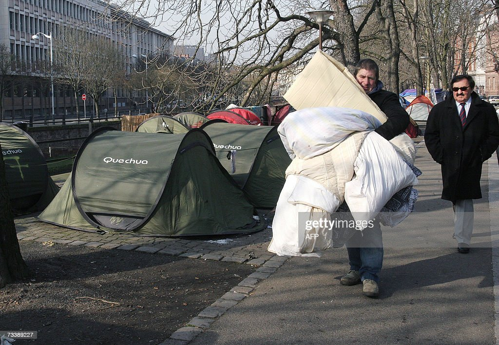 A member of 'Les Enfants de Don Quichotte' (The Children of Don Quixote) association, folds his tent, after being sheltered in a hotel following an agreement with the Bas-Rhin Prefecture in Strasbourg, 22 February 2007.