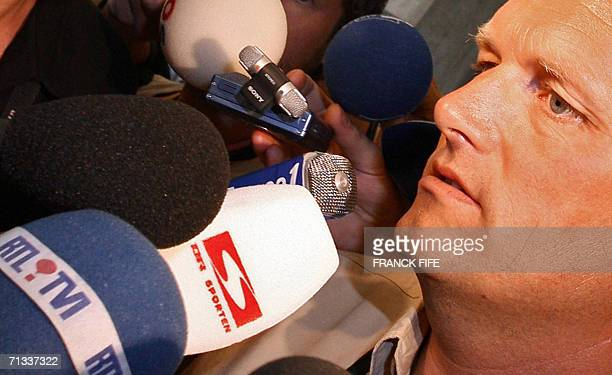 CSC Team Manager Bjarne Riis answers journalists' questions as he arrives at the Palais de la Musique to attend a meeting gathering all the teams'...