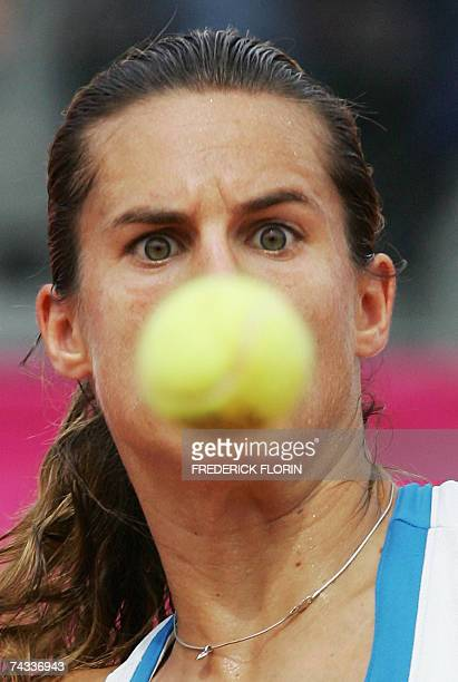 French Amelie Mauresmo looks at the ball prior to hit a return to Spanish opponent Anabel Medina Garrigues during their final match at the WTA...