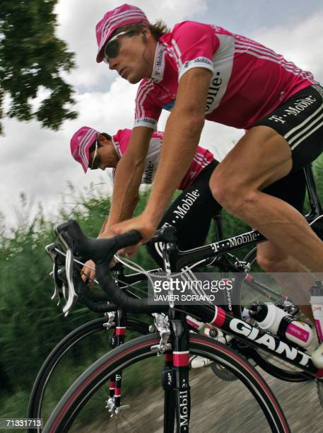 Germany's Jan Ullrich rides by his Spanish teammate Oscar Sevilla during a training session two days before the official start of the 93rd Tour de...