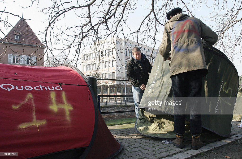 Members of 'Les Enfants de Don Quichotte' (The Children of Don Quixote) association, fold their tent, after being sheltered in a hotel following an agreement with the Bas-Rhin Prefecture in Strasbourg, 22 February 2007.