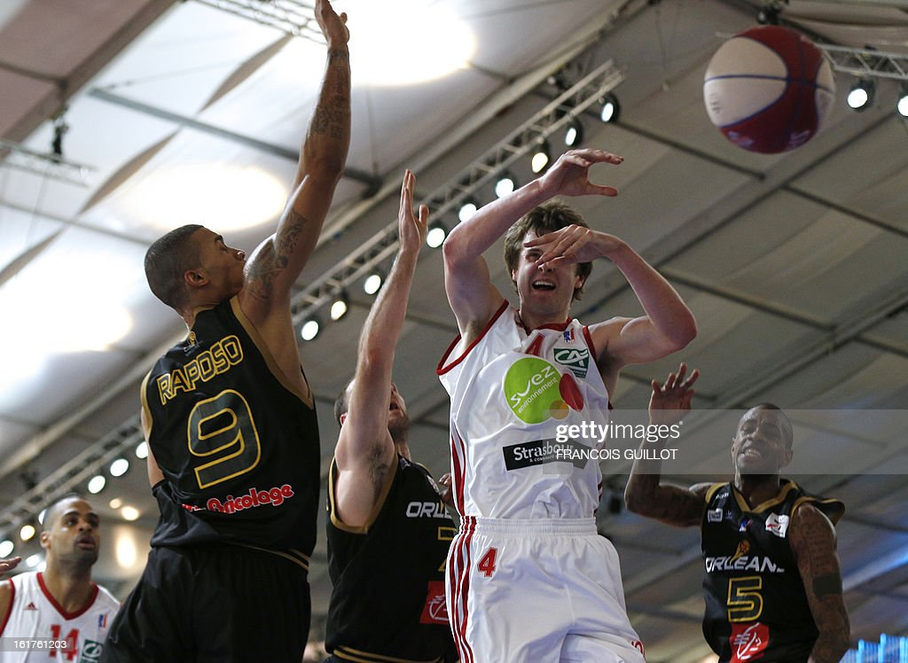 Strasbourg IG player John Shurna (R) vies with Orleans Loiret Basket player Fernando Raposo (L) during the leaders cup LNB 2013 tournament basketball quarter final match on February, 15, 2013 in Marne-la-Vallee, near Paris