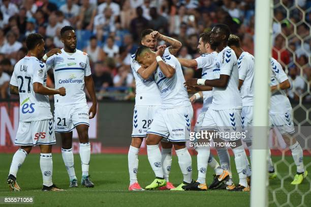 Strasbourg's French forward Idriss Saadi celebrates with his teammates after scoring a goal during the French L1 football match between Montpellier...