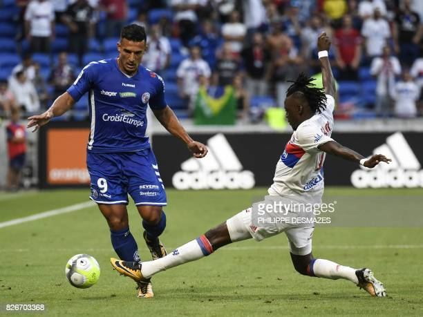 Strasbourg's French forward Idriss Saadi is tackled by Lyon's Burkibanese midfelder Andre Traore during the Ligue1 football match Olympique Lyonnais...