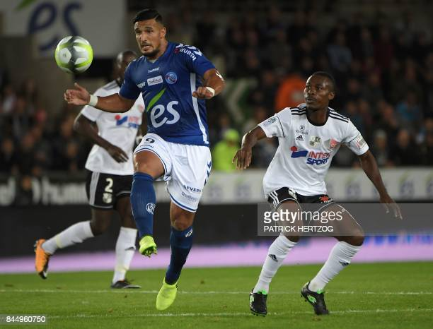 Strasbourg's French forward Idriss Saadi vies with Amiens' Beninese defender Khaled Adenon during the French Ligue 1 football match between...