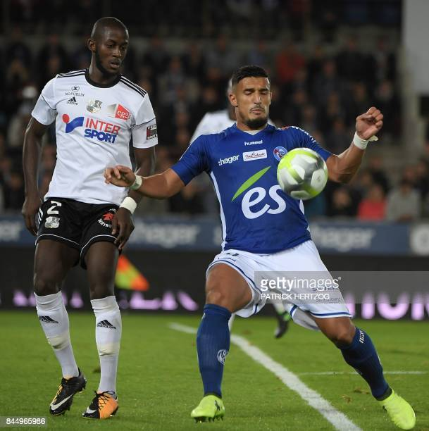 Strasbourg's French forward Idriss Saadi vies with Amiens' French defender PrinceDe Gouano during the French Ligue 1 football match between...