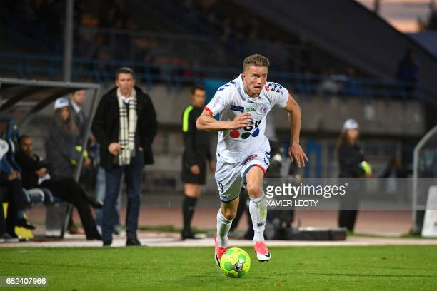 Strasbourg's Belgian forward Baptiste Guillaume runs with ball during the French L2 football match between Niort and Strasbourg on May 12 in Niort /...