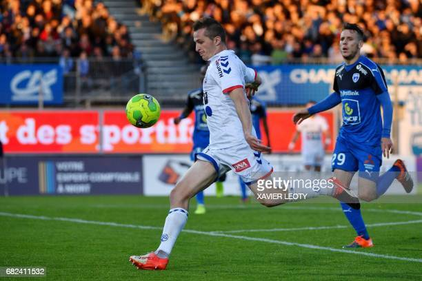 Strasbourg's Belgian forward Baptiste Guillaume shoots the ball during the French L2 football match between Niort and Strasbourg on May 12 in Niort /...
