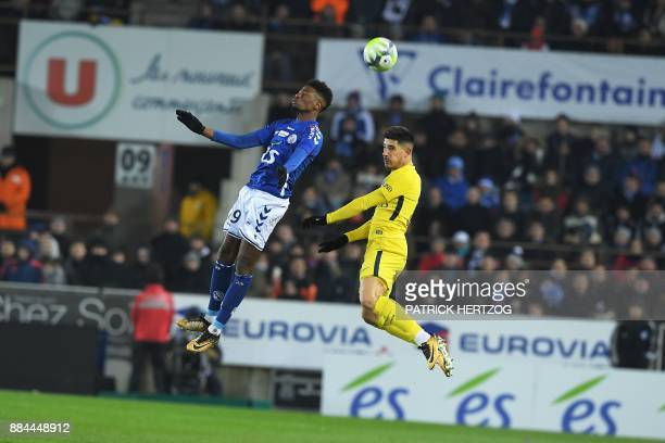 Strasbourg's Cape Verdian forward Nuno Da Costa and Paris SaintGermain's Spanish defender Yuri Berchiche jump for the ball during the French L1...