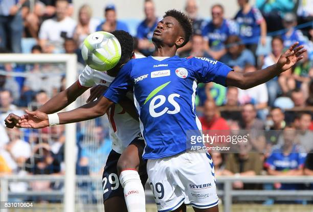 Strasbourg's Cape Verdian forward Nuno Da Costa fights for the ball with Lille's Malian midfielder Rominigue Kouame during the French Ligue 1...