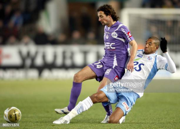 Strasbourg's defender Habib Bellaid and Toulouse's defender Pantxi Gilles Sirieix fight for the ball during their French L1 football match Strasbourg...