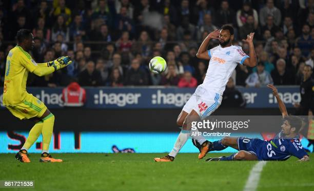 Strasbourg's French forward Martin Terrier vies with Olympique de Marseille's Portuguese defender Rolando and Olympique de Marseille's French...