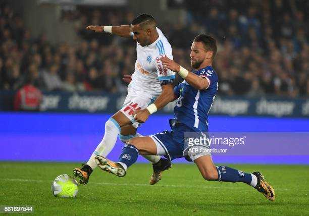 Strasbourg's French midfielder Anthony Goncalves vies with Olympique de Marseille's French forward Dimitri Payet during the French Ligue 1 football...