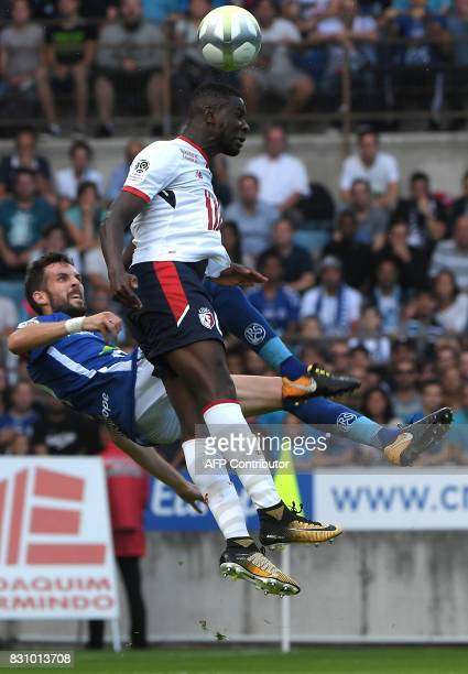 Strasbourg's French midfielder Benjamin Corgnet fights for the ball with Lille's Portuguese defender Edgar Ie during the French Ligue 1 football...