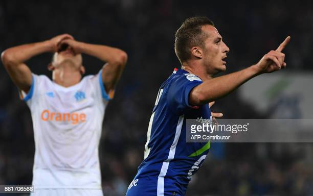 Strasbourg's French midfielder Dimitri Lienard celebrates after scoring a goal as Olympique de Marseille's French midfielder Florian Thauvin reacts...