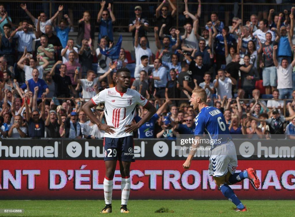 Strasbourgs French Midfielder Jeremy Grimm R Celebrates His Goal As Lilles Malian Midfielder Rominigue