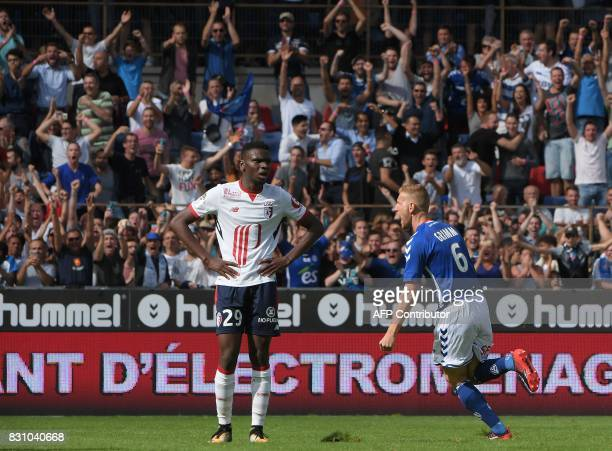 Strasbourg's French midfielder Jeremy Grimm celebrates his goal as Lille's Malian midfielder Rominigue Kouame looks on during the French Ligue 1...