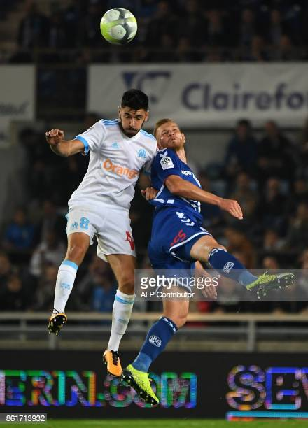 Strasbourg's French midfielder Jeremy Grimm vies with Olympique de Marseille's French midfielder Morgan Sanson during the French Ligue 1 football...