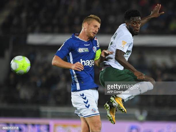 Strasbourg's French midfielder Jeremy Grimm vies with SaintEtienne's French forward Jonathan Bamba during the French League Cup round of 16 football...
