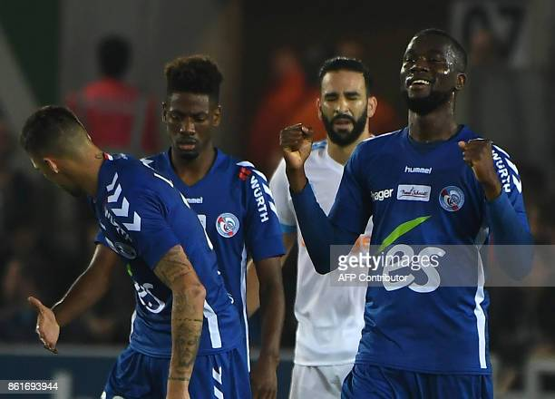 Strasbourg's Ivorian defender JeanEudes Aholou celebrates after scoring a goal during the French Ligue 1 football match between Strasbourg and...