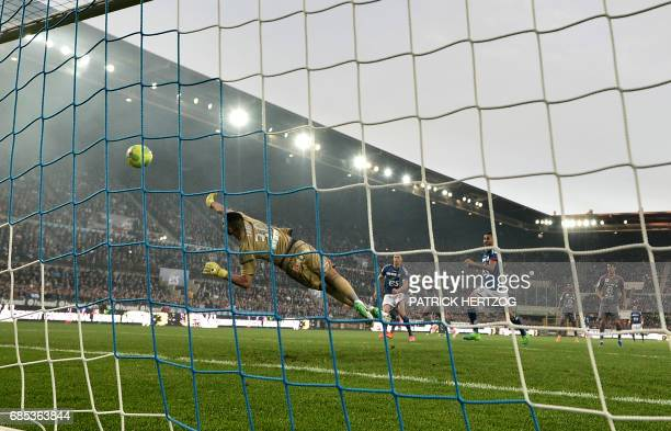 Strasbourg's Kader Mangane shoots to score a goal during the French L2 football match between Strasbourg and BourgenBresse at the Meinau stadium on...