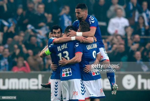 Strasbourg's players celebrate after scoring a goal during the French L2 football match between Strasbourg and BourgenBresse at the Meinau stadium on...
