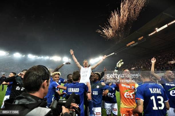 Strasbourg's players celebrate after the French L2 football match between Strasbourg and BourgenBresse at the Meinau stadium on May 19 2017 in...