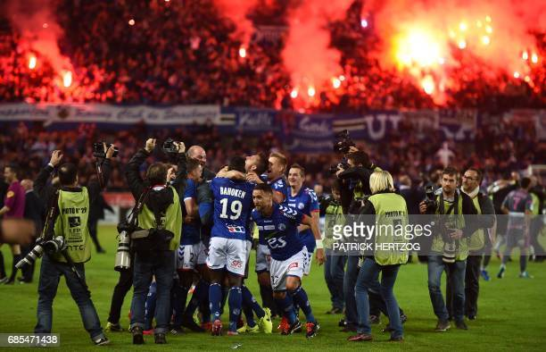 Strasbourg's players celebrate after the French L2 football match between Strasbourg and BourgenBresse at the Meinau stadium in Strasbourg eastern...