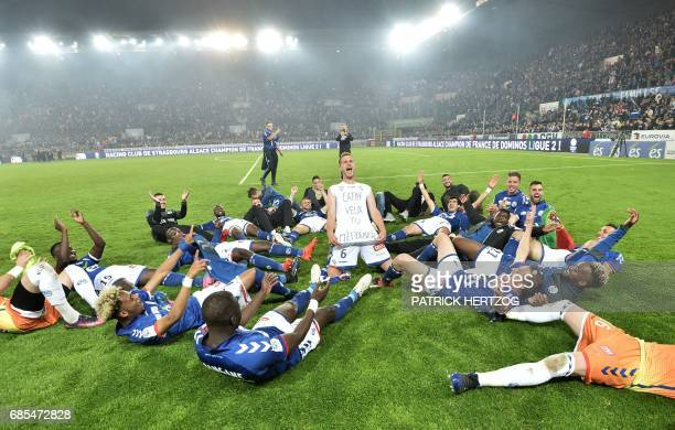 TOPSHOT Strasbourg's players celebrate after the French L2 football match between Strasbourg and BourgenBresse at the Meinau stadium on May 19 2017...